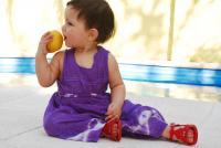 baby eating peach